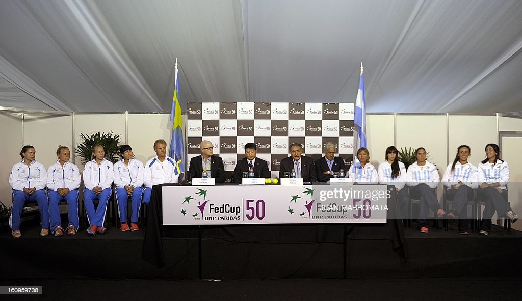 Sweden's (L) and Argentina's tennis teams attend the draw of their 2013 Fed Cup World Group II first round to be held this weekend, at Parque Roca stadium in Buenos Aires on February 8, 2012. AFP PHOTO / Juan Mabromata