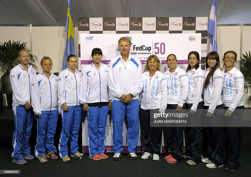 Sweden's (L) and Argentina's tennis teams pose for pictures after the draw of their 2013 Fed Cup World Group II first round to be held this weekend, at Parque Roca stadium in Buenos Aires on February 8, 2012. For Sweden (L-R) tennis players Johanna Larsson, Hilda Melander, Sandra Roma, Sofia Arvidsson and team captain Lars-Anders Wahlgren and for Argentina (L-R) team captain Bettina Fulco and tennis players Florencia Molinero, Maria Irigoyen, Paula Ormaechea and Mailen Auroux. AFP PHOTO / Juan Mabromata