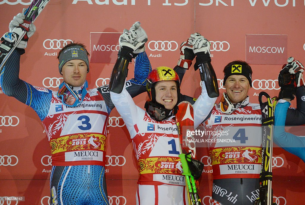 Sweden's Andre Myhrer (second place), Austria's Marcel Hirscher (first place) and Croatia's Ivica Kostelic (third place) celebrate on the podium after the FIS Ski World Cup Parallel Slalom city event in Moscow on January 29, 2013.