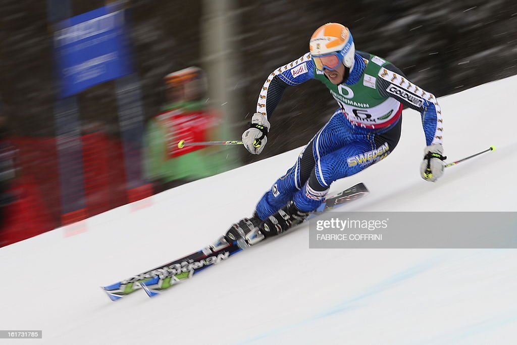 Sweden's Andre Myhrer skis during the first run of the men's Giant slalom at the 2013 Ski World Championships in Schladming, Austria on February 15, 2013. AFP PHOTO / FABRICE COFFRINI