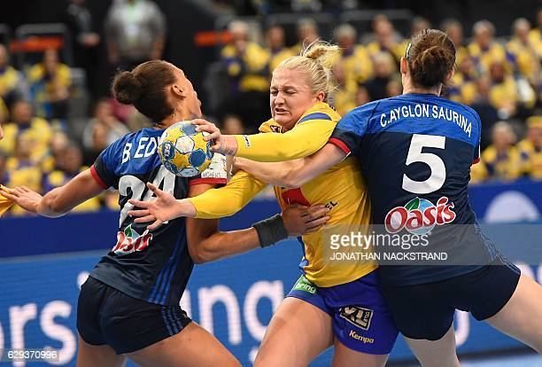 TOPSHOT Sweden's Anna Lagerquist view with France's Beatrice Edwige and Camille Ayglon during the Women's European Handball Championship Group I...