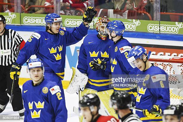 Sweden's Anton Karlsson Adam Ollas Mattsson goalie Felix Sandstrom Jens Looke and Andreas Englund celebrate after beating Canada 25 during the 2016...
