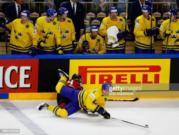 Sweden's Anton Stralman and Canada's Nate Mackinnon vie during the IIHF Men's World Championship Ice Hockey final match between Canada and Sweden in...