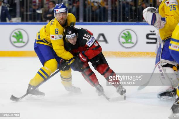 Sweden's Anton Stralman vies with Canada's Mitch Marner during the IIHF Men's World Championship Ice Hockey final game match between Canada and...