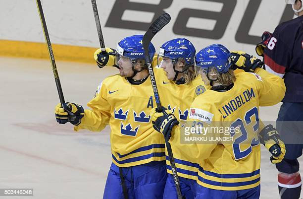Sweden's Axel Homstroem William Lagesson and Oskar Lindbom celebrate the 12 goal by William Lagesson during the 2016 IIHF World Junior Ice Hockey...