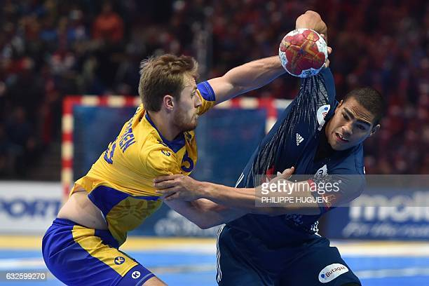 TOPSHOT Sweden's back Albin Lagergren defends on France's centre back Daniel Narcisse during the 25th IHF Men's World Championship 2017 quarter final...