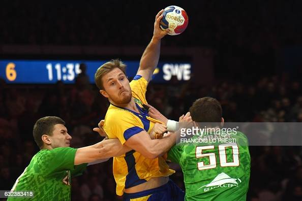TOPSHOT CORRECTION Sweden's back Albin Lagergren vies with Belarus' left back Aliaksei Shynkel and Belarus' pivot Artsem Karalek during the 25th IHF...