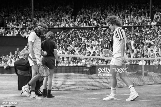 Sweden's Bjorn Borg swaps sides with John MacEnroe on the Centre Court at Wimbledon where he won his fifth successive men's singles title with a...