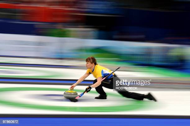 Sweden's Cathrine Lindahl releases a stone during the China vs Sweden women's curling semifinal match against Switzerland at the Vancouver Olympic...