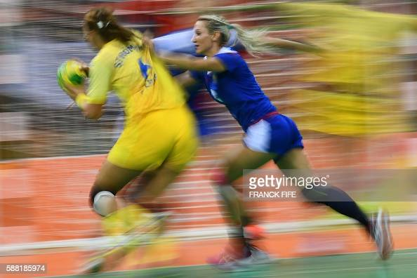 TOPSHOT Sweden's centre back Carin Stromberg vies with Russia's left wing Polina Kuznetsova during the women's preliminaries Group B handball match...