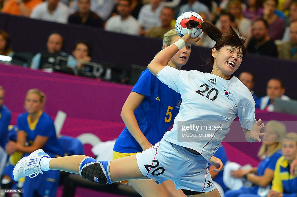Sweden's centreback Isabelle Gullden jumps to shoot during the women's preliminary Group B handball match Sweden vs South Korea for the London 2012 Olympics Games on August 4, 2012 at the Copper Box hall in London. AFP PHOTO/ MIGUEL MEDINA