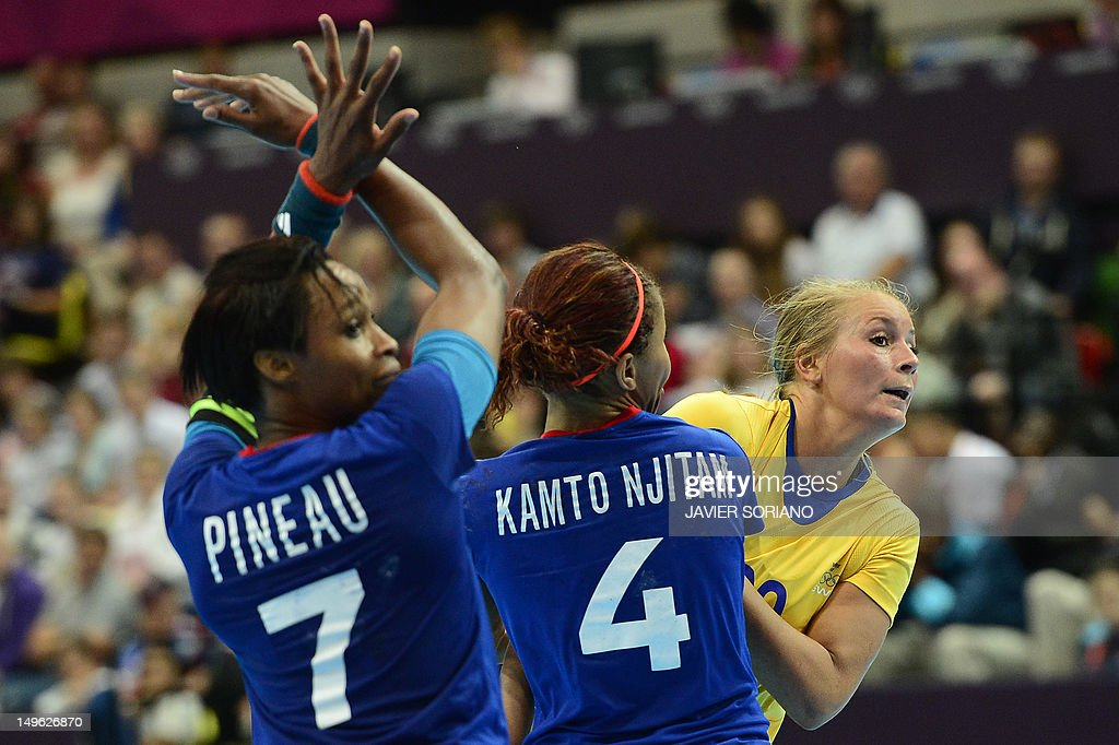 Sweden's centreback Isabelle Gullden (R) vies with french players during the women's preliminaries Group A handball match France vs Sweden for the London 2012 Olympics Games on August 1, 2012 at the Copper Box hall in London. France won 29-17.