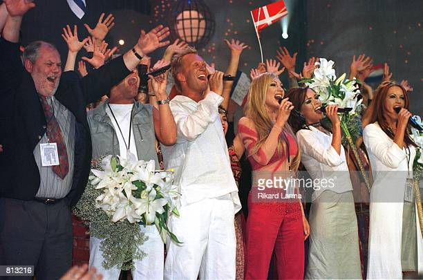 Sweden's Charlotte Nilsson along with her group cheer after winning the Eurovision ''99 song contest May 30 1999 in Jerusalem Nilsson won with her...