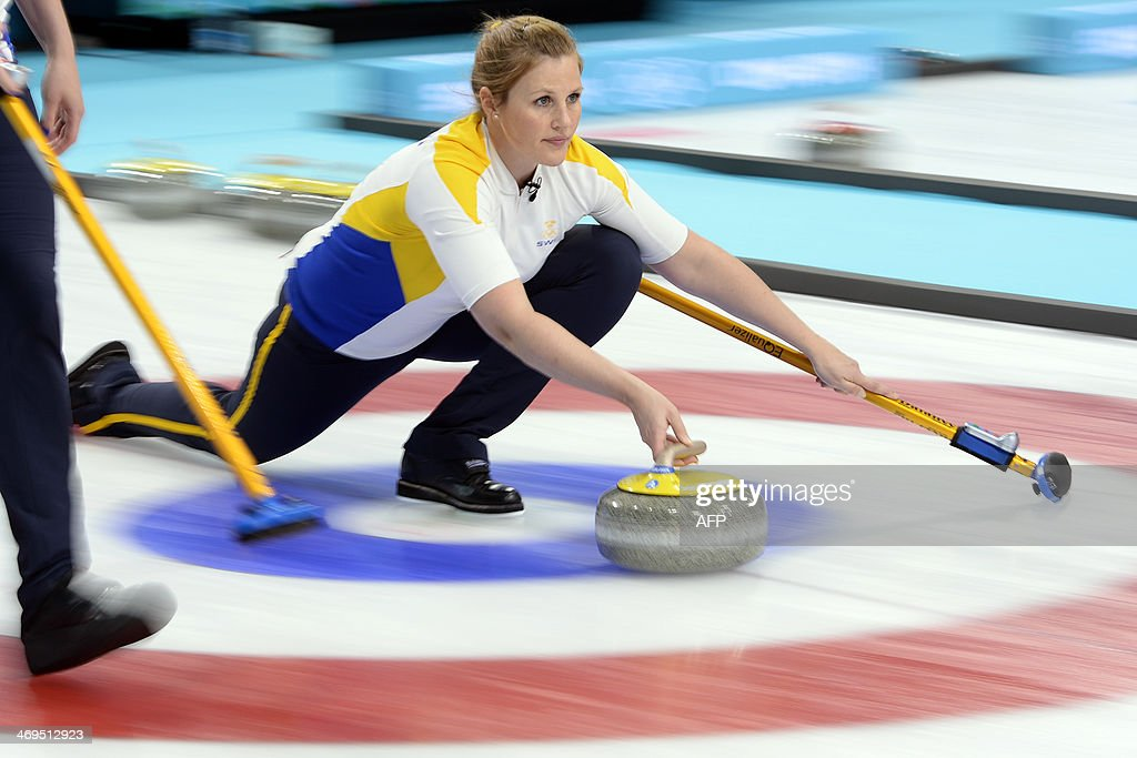 Sweden's Christina Bertrup trows the stone during the Women's Curling Round Robin Session 9 against US at the Ice Cube Curling Center during the...