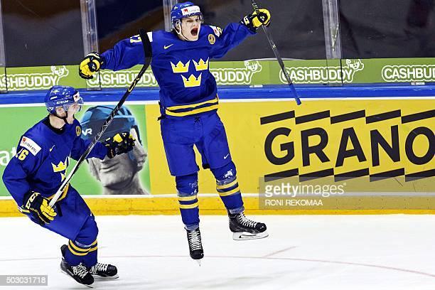 Sweden's Christoffer Ehn and 14 goal scorer Anton Karlsson celebrate during the 2016 IIHF World Junior U20 Ice Hockey Championships tournament match...