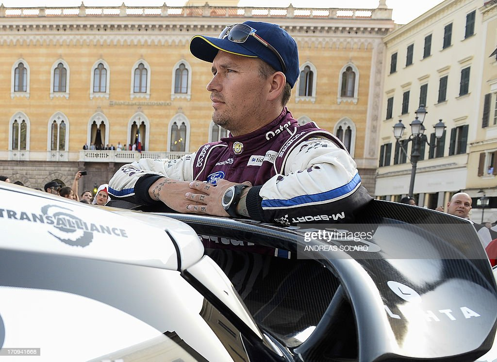 Sweden's co-driver Jonas Andersson of Ford Fiesta RS WRC looks on during the opening ceremony of the FIA World Rally Championship of Italy in Sassari, on the Italian island of Sardinia on June 20, 2013.