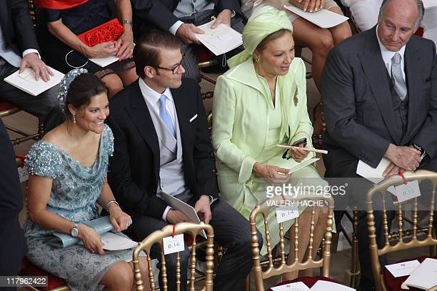 Sweden's Crown Princess Victoria and her husband Prince Daniel sit next to Iran's former Queen Farah Pahlavi and of Prince Karim Aga Khan before the...