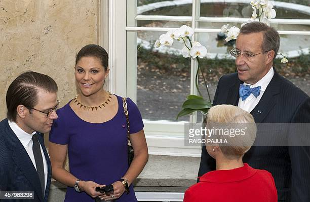 Sweden's Crown Princess Victoria and her husband Prince Daniel talk with the President of Estonia Toomas Hendrik Ilves and his wife Evelin Ilves as...