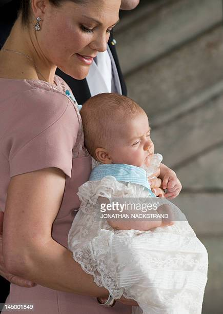 Sweden's Crown Princess Victoria and Prince Daniel leave on May 22 2012 the christening of their daughter Princess Estelle at the Royal Chapel in...