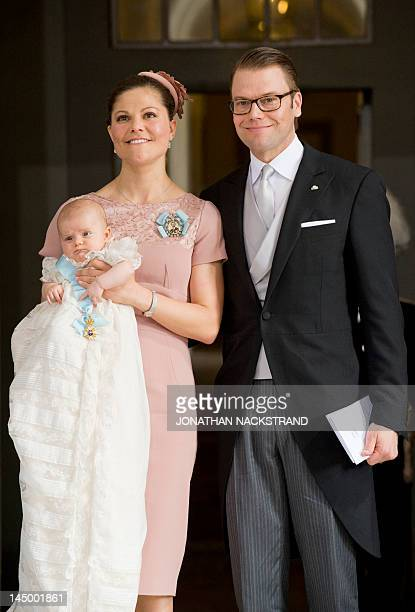 Sweden's Crown Princess Victoria and Prince Daniel leave on May 22 2012 after the christening of their daughter Princess Estelle at the Royal Chapel...