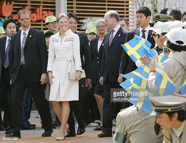Sweden's Crown Princess Victoria is weclomed by Japanese waving Swedish national flags upon her arrival at the Nordic Pavilion of the 2005 world...