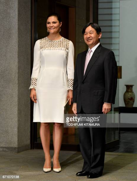 Swedens Crown Princess Victoria is welcomed by Japanese Crown Prince Naruhito upon her arrival at the entrance of Togu Palace to hold a banquet in...