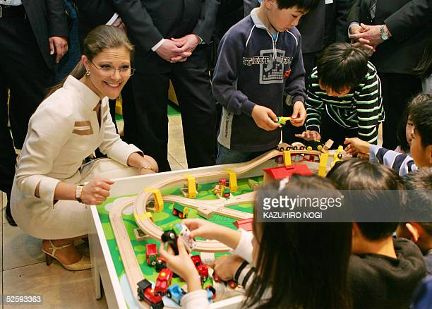 Sweden's Crown Princess Victoria meets with Japanese children during a tour of a Swedish made toy shop in a department store of Nagoya Aichi...