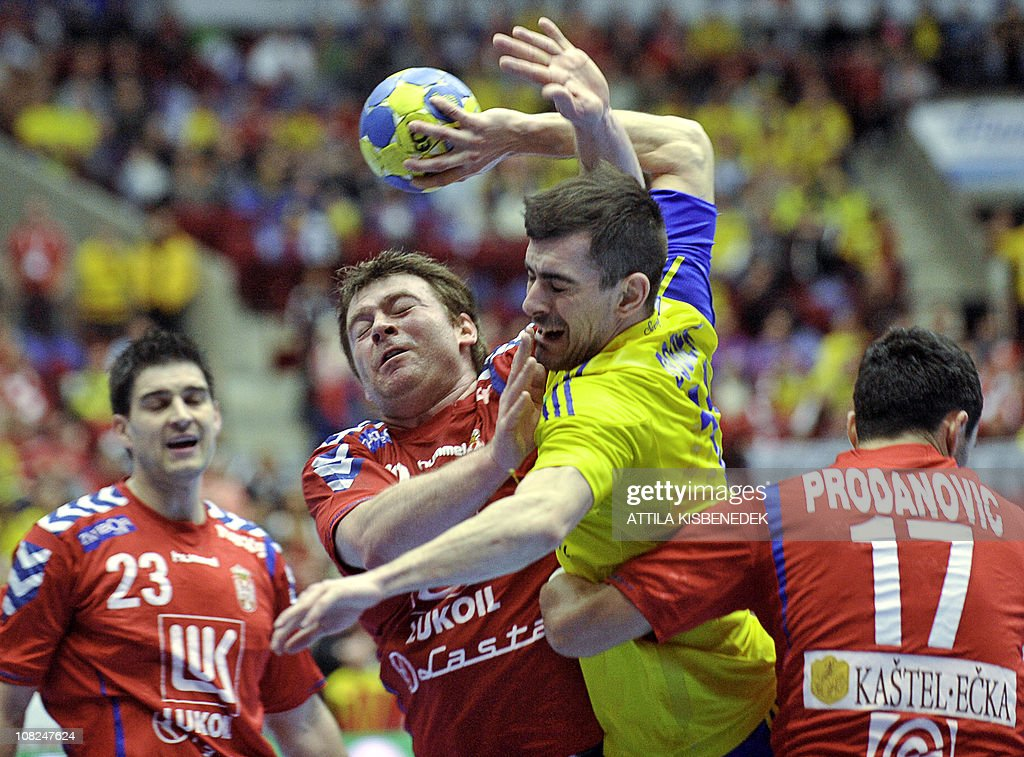 Sweden's Dalibor Doder (2ndR) vies with Serbia's Alem Toskic (2ndL) and Rajko Prodanovic (R) as Serbian's Nenad Vuckovic (L) looks on during their 22nd Men's Handball World Championships Main Two group match at the Malmo Arena on January 22, 2011. AFP PHOTO / ATTILA KISBENEDEK
