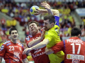 Sweden's Dalibor Doder vies with Serbia's Alem Toskic and Rajko Prodanovic as Serbian's Nenad Vuckovic looks on during their 22nd Men's Handball...