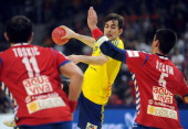 Sweden's Dalibor Doder vies with Serbia's Alem Toskic and Zarko Sesum during the men's EHF Euro 2012 Handball Championship match between Serbia and...