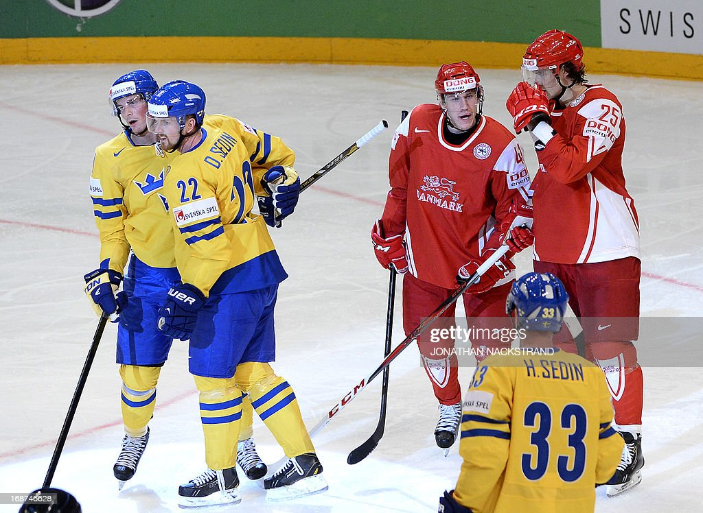 Sweden's Daniel Sedin (#22) celebrates with his teammates after scoring during the preliminary round match Denmark vs Sweden at the 2013 IIHF Ice Hockey World Championships on May 14, 2013 in Stockholm.