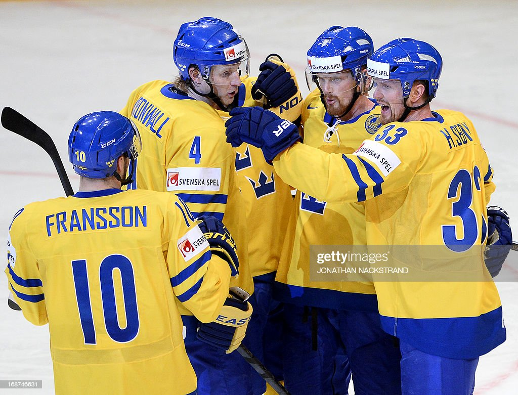 Sweden's Daniel Sedin (2nd-R) celebrates with his teammates after scoring during the preliminary round match Denmark vs Sweden at the 2013 IIHF Ice Hockey World Championships on May 14, 2013 in Stockholm.