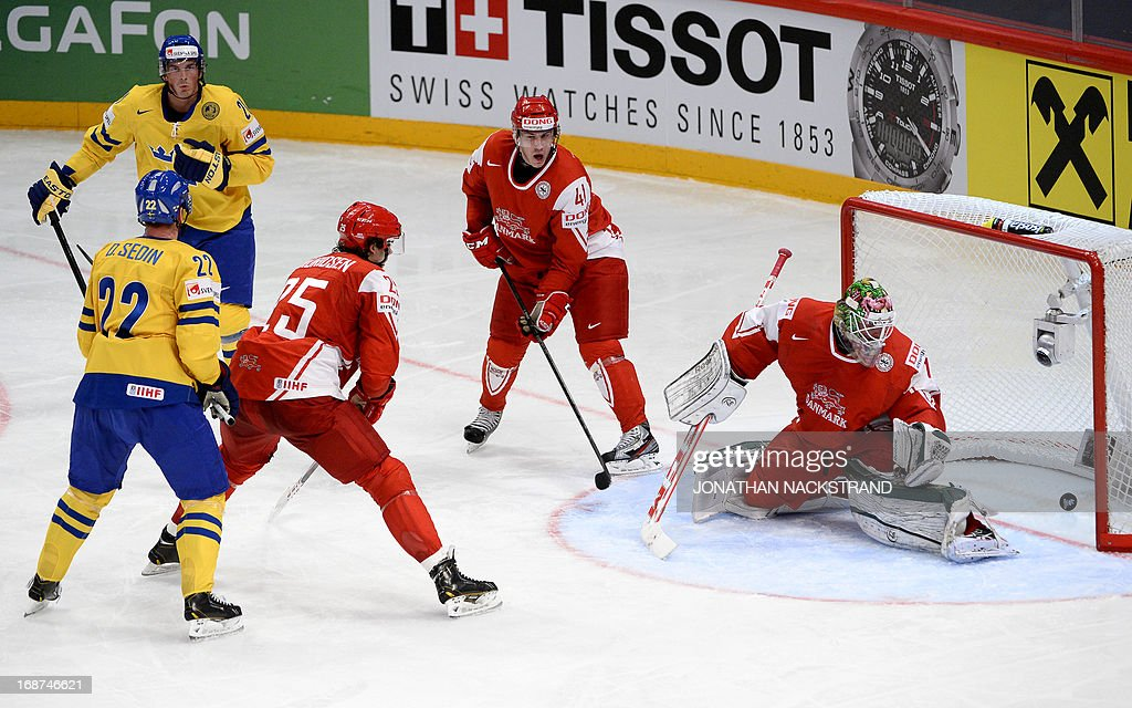 Sweden's Daniel Sedin (L) scores on Denmark's goalkeeper Patrick Galbraith during the preliminary round match Denmark vs Sweden at the 2013 IIHF Ice Hockey World Championships on May 14, 2013 in Stockholm.