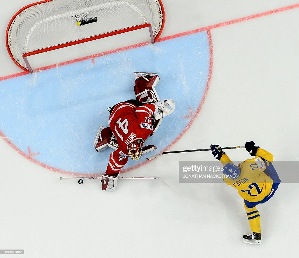 Sweden's Daniel Sedin tries to score on Canada's goalkeeper Mike Smith during a shootout at the quarterfinals match Canada vs Sweden at the 2013 IIHF Ice Hockey World Championships on May 16, 2013 in Stockholm. Sweden won 3-2. AFP PHOTO/JONATHAN NACKSTRAND / AFP / Jonathan NACKSTRAND