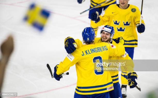 Sweden´s defender John Klingberg and team mates celebrate scoring the 21 goal during the IIHF Men's World Championship Ice Hockey semifinal match...