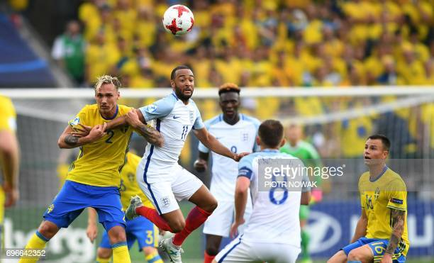 Sweden's defender Linus Wahlqvist vies with England's Nathan Redmont during an UEFA U21 European Championship Group A football match between Sweden...