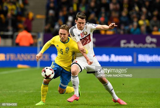Sweden's defender Ludwig Augustinsson and Belarus' forward Nikolai Signevich vie for the ball during the FIFA World Cup 2018 qualification football...