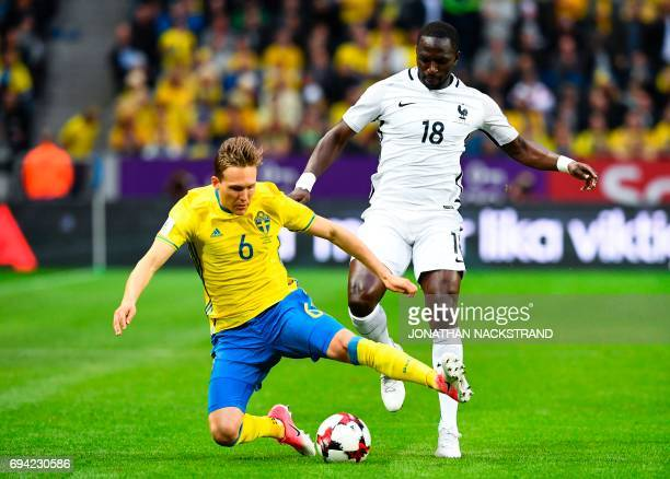 Sweden's defender Ludwig Augustinsson and France's midfielder Moussa Sissoko vie for the ball during the FIFA World Cup 2018 qualification football...