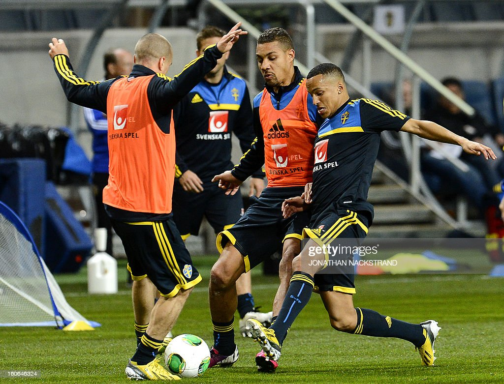 Sweden's defender Martin Olsson (R), forward Mathias Ranegie (C) and midfielder Samuel Holmen take part in a training session of the Swedish national football team at the 'Friends Arena' in Stockholm, Sweden, on February 4, 2013 two days before the FIFA World Cup 2014 friendly match Sweden vs Argentina.