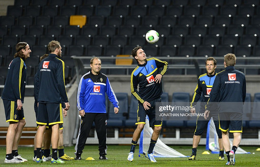 Sweden's Defender Mikael Lustig (C) takes part in a training session of the Swedish national football team at the 'Friends Arena' in Stockholm, Sweden, on February 4, 2013 two days before the FIFA World Cup 2014 friendly match Sweden vs Argentina. AFP PHOTO/JONATHAN NACKSTRAND