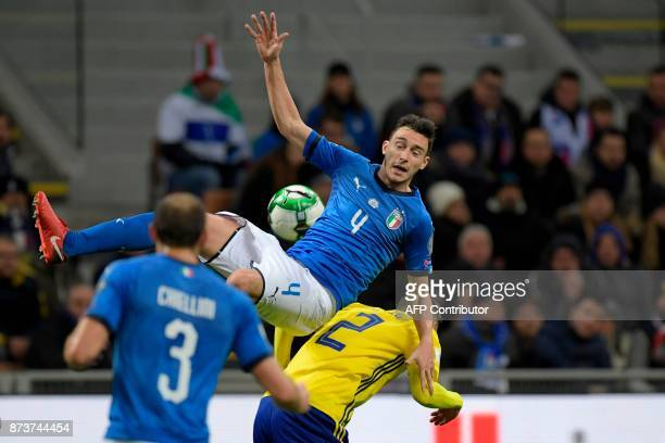Sweden's defender Mikael Lustig vies with Italy's midfielder Matteo Darmian during the FIFA World Cup 2018 qualification football match between Italy...