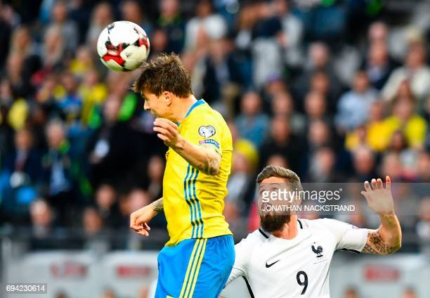 Sweden's defender Victor Lindelof and France's forward Olivier Giroud vie for the ball during the FIFA World Cup 2018 qualification football match...