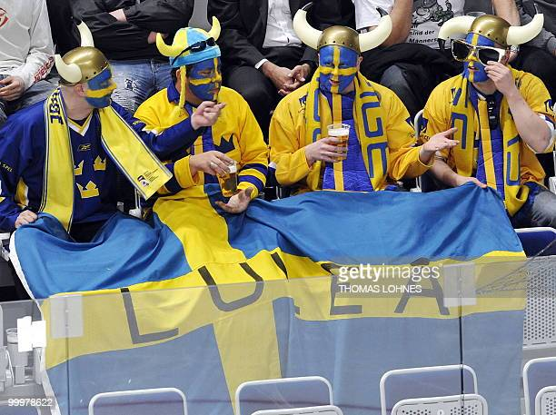Sweden's fans sit on the tribune during the IIHF Ice Hockey World Championship match Switzerland vs Sweden in the southern German city of Mannheim on...