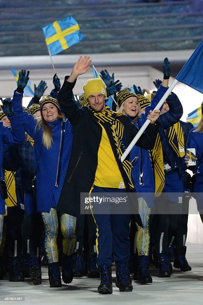 Sweden's flag bearer crosscountry skier Anders Soedergren leads his national delegation during the Opening Ceremony of the Sochi Winter Olympics at...