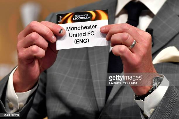 Sweden's former defender and 2017 Europa League final ambassador Patrik Andersson shows a piece of paper bearing the name of Manchester United FC...