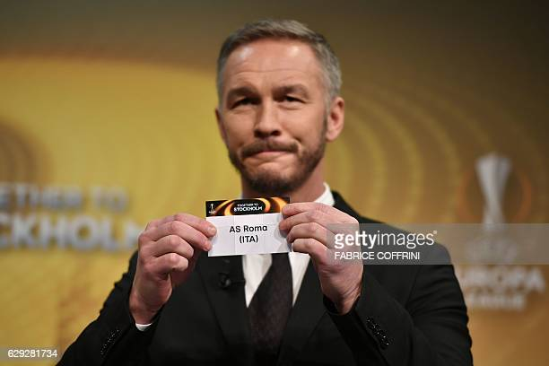 Sweden's former defender and 2017 Europa League final ambassador Patrik Andersson holds the name of AS Roma during the draw for the round of 32 of...