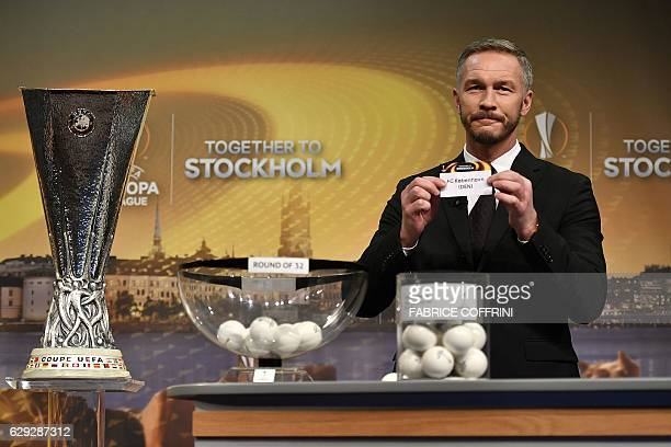 Sweden's former defender and 2017 Europa League final ambassador Patrik Andersson holds the name of Copenhagen during the draw for the round of 32 of...