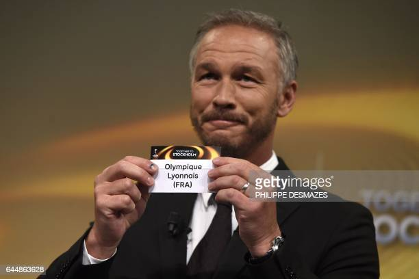 Sweden's former defender and 2017 Europa League final ambassador Patrik Andersson shows the name of Lyon during the draw for the round of 16 of the...