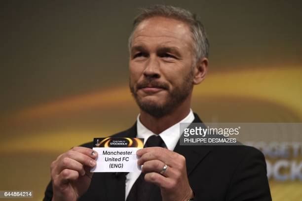 Sweden's former defender and 2017 Europa League final ambassador Patrik Andersson shows the name of Manchester United during the draw for the round...