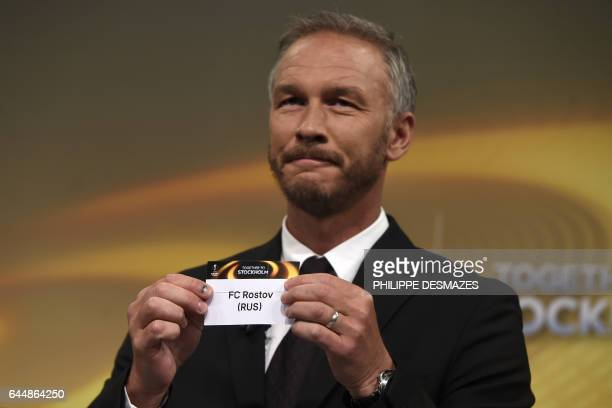 Sweden's former defender and 2017 Europa League final ambassador Patrik Andersson shows the name of Rostov during the draw for the round of 16 of the...